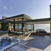 On this home, the roof continues out beyond estate, home, house, property, real estate, swimming pool, villa