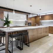 This kitchen is a step up from the cabinetry, countertop, cuisine classique, interior design, kitchen, real estate, gray