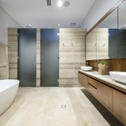 This master ensuite is positioned internally within the bathroom, floor, interior design, room, sink, gray