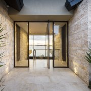 The pivot front door opens to present guests apartment, courtyard, door, estate, facade, home, house, property, real estate, window, gray