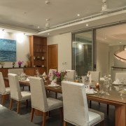 Access to this dining room is from a ceiling, dining room, function hall, interior design, restaurant, room, table, brown
