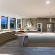 This island's conical elements echo the form of countertop, estate, interior design, kitchen, real estate, gray