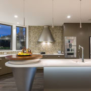 This island includes an under-lit countertop for dramatic architecture, ceiling, countertop, home, interior design, kitchen, room, sink, gray