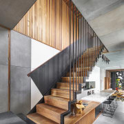 A  black steel, custom suspended staircase helps architecture, handrail, house, interior design, stairs, wood, gray