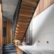 Visually, this kitchens material palette is restrained: the architecture, daylighting, house, interior design, stairs, wood, gray