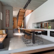 Timber steps provide a subtle delineation between the architecture, house, interior design, living room, gray