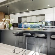 On this renovation by Pepper Design, a new, countertop, interior design, kitchen, gray, white