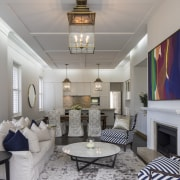 This home's run of informal family rooms culminates ceiling, interior design, living room, real estate, room, gray