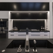 On this project, wood panelling concealing the rangehood cabinetry, countertop, interior design, kitchen, kitchen stove, product design, black, gray