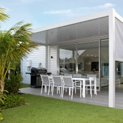 This drop-down side screen, part of the Bask architecture, house, outdoor structure, real estate, shade, white