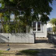 A demure heritage-protected street facade provides little indication building, cottage, estate, facade, fence, home, house, neighbourhood, outdoor structure, picket fence, plant, property, real estate, residential area, tree, walkway, black