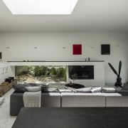In this addition, the low wall to the architecture, house, interior design, living room, room, gray