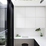 This study space looks out onto a small architecture, furniture, house, interior design, product design, white