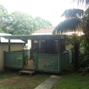 The original rear of this 1930s bungalow had area, backyard, cottage, grass, house, outdoor structure, property, real estate, roof, shed, tree, black, white