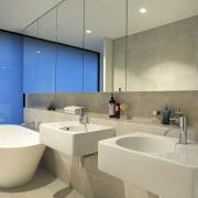 This minimalist bathroom achieves a sense of space architecture, bathroom, interior design, product design, room, sink, brown, orange
