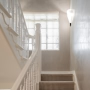 Original detailing was retained in this transformation of architecture, baluster, ceiling, daylighting, estate, floor, handrail, home, house, interior design, property, stairs, structure, gray