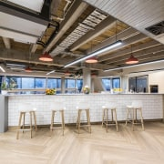 The staff kitchen facilities at My Food Bag ceiling, daylighting, floor, flooring, interior design, lobby, loft, real estate, gray, brown