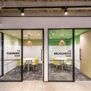 Colour highlights that reflect company branding or its door, interior design, lobby, real estate, gray