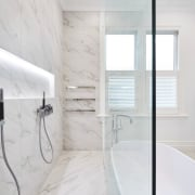 Uninterrupted swathes of marble-look porcelain tiles provide a architecture, bathroom, floor, flooring, home, interior design, product design, room, tap, tile, white