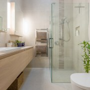 A high picture rail visually breaks up the architecture, bathroom, floor, home, interior design, room, tile, gray