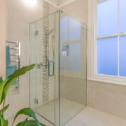 For visual interest a strip of mosaic tiles bathroom, glass, property, real estate, room, window, gray