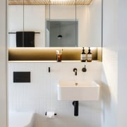 LED lighting washes a plasterboard ceiling above the architecture, bathroom, interior design, plumbing fixture, product design, room, sink, tap, gray