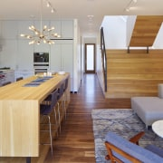 Entrance into this home from street level leads architecture, ceiling, floor, flooring, furniture, hardwood, interior design, laminate flooring, living room, real estate, room, table, wall, wood, wood flooring, gray
