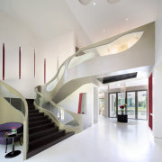 Flowing terrazzo floors add to the sense of architecture, ceiling, daylighting, house, interior design, product design, real estate, stairs, gray, white