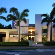 Two artistic panels with LED-lit niches allow this architecture, arecales, building, commercial building, condominium, corporate headquarters, elevation, estate, facade, home, house, lighting, mansion, mixed use, palm tree, property, real estate, residential area, sky, black