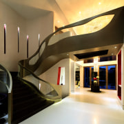 Back-lit wall niches set off this atrium in architecture, ceiling, interior design, lobby, stairs, brown