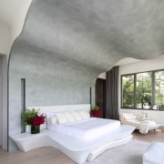 This master bedroom has a rippling, rising bedhead architecture, bed frame, ceiling, daylighting, floor, home, house, interior design, mattress, wall, gray