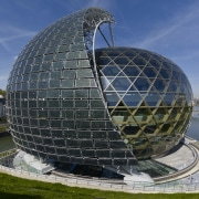 A sail comprised of solar panels appears to architecture, biome, building, dome, landmark, sky, sphere, black