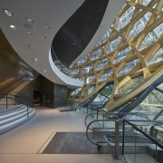 Inside out  the foyer wraps around the architecture, building, ceiling, daylighting, headquarters, interior design, leisure centre, lobby, mixed use, performing arts center, stairs, structure, gray