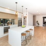 The entertainer's kitchen in this Sentinel Homes showhome countertop, floor, interior design, kitchen, property, real estate, room, white