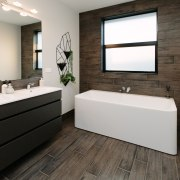 In this Sentinel Homes showhome, the designer bathroom bathroom, floor, interior design, product design, room, white, black
