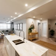 Hereford Residences take in sweeping harbour views in ceiling, floor, flooring, interior design, kitchen, living room, real estate, room, gray, brown