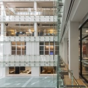 Looking into the office floors on the new apartment, architecture, building, condominium, daylighting, facade, glass, interior design, lobby, mixed use, real estate, gray