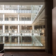 Looking out from the new offices to the apartment, architecture, building, condominium, daylighting, glass, interior design, lobby, window, black