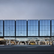 The Giltrap Group building commands attention in the architecture, building, commercial building, corporate headquarters, daytime, facade, headquarters, infrastructure, metropolitan area, sky, structure, teal, gray