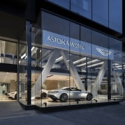 Each of the three premium car brands at airport terminal, automotive design, bmw, building, car, car dealership, luxury vehicle, motor vehicle, structure, technology, transport, vehicle, black