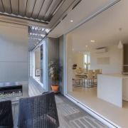 Operable shutters contribute to an indoor-outdoor lifestyle at architecture, daylighting, estate, house, interior design, kitchen, property, real estate, gray