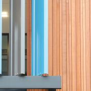 Timber batons meet fixed metal louvres on the angle, door, hardwood, wall, window, wood, wood stain, orange