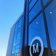 Te Ara o Mauao includes a glass-fronted entry architecture, blue, building, corporate headquarters, daylighting, daytime, facade, line, metropolitan area, sky, structure, blue, teal
