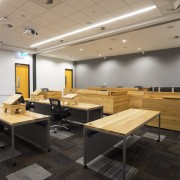 The moot court in the new Law and ceiling, conference hall, furniture, interior design, office, table, gray, black