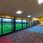 The new ACG Gymnasium offers plenty of natural architecture, ceiling, daylighting, floor, flooring, interior design, leisure centre, real estate, sport venue, structure, wall, brown