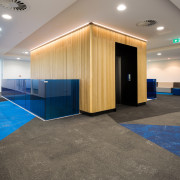 At the Sistema building, lift entries are finished floor, flooring, interior design, lobby, real estate, gray