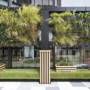 Hanging gardens on the perimeter wall of Cosmokids architecture, arecales, condominium, facade, grass, home, house, neighbourhood, outdoor structure, palm tree, plant, property, real estate, residential area, tree, black