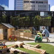 Cosmokids' sunny outdoor play area sits at third architecture, backyard, home, house, neighbourhood, playground, public space, recreation, residential area, black