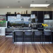 This gleaming kitchen is something of an art countertop, floor, flooring, interior design, kitchen, gray, black