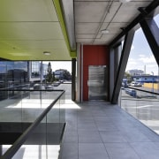 Broad walkways provide a direct circulation link from architecture, building, daylighting, gray